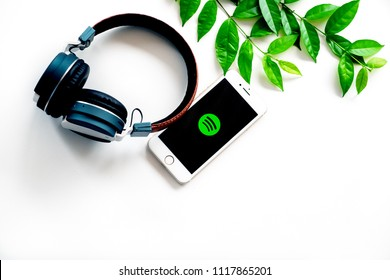 Nonthaburi, Thailand - June 17, 2018: Flat lay of headphone and smart phone which showing Spotify app icon on screen. Spotify is one of popular digital music providers. Image with copy space.