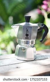 Nonthaburi, Thailand - June 6 2020 : Silver Moka Pot - 1 Cup, Bialetti Moka Express, Brewing the fresh coffee in the green garden background