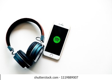 Nonthaburi, Thailand - June 7, 2018: Flat lay of headphone and smart phone with Spotify app icon on screen. Spotify is one of popular digital music providers. Image with copy space.