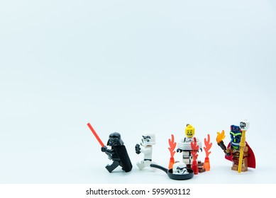 Nonthaburi, Thailand - March, 07, 2017 : Lego star wars stormtrooper was the tribe caught the bundle burn on fire to sacrifice isolated on white background.