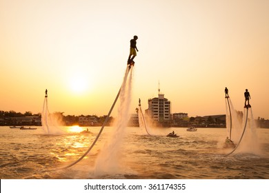NONTHABURI, THAILAND - March 1, 2015:  Silhouette and vintage color styl  of showing flyboard on Chaophya river during Chinese new year celebrations on March 1, 2015 Nonthaburi, Thailand.