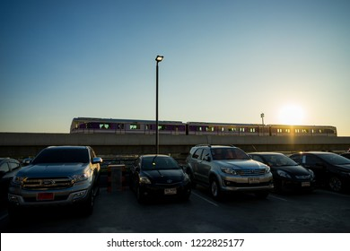 Nonthaburi, Thailand - March 17:  MRT sky train Purple Line is running on the evening. view from Central plaza westgate car park. on March 17, 2018 in Nonthaburi, Thailand.