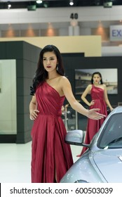 NONTHABURI, THAILAND - MARCH 28: Unidentified female model posts at the Aston Martin Booth during the 37th Bangkok International Motor Show 2016 on March 28, 2016 in Nonthaburi, Thailand.