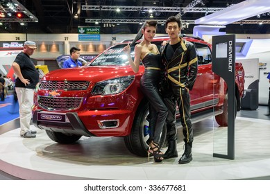 NONTHABURI, THAILAND - MARCH 30: Unidentified couple models with the Chevrolet High Country is on display at the 36th Bangkok International Motor Show 2015 on March 30, 2015 in Nonthaburi, Thailand.