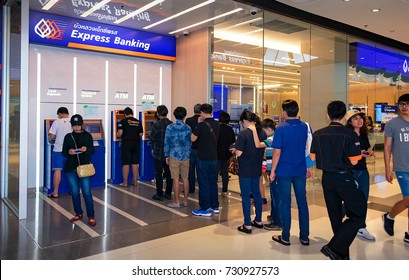 NONTHABURI, THAILAND - OCTOBER 08: Bank customers line up to use the Bangkok Bank ATM machine in CentralPlaza Westgate in Nonthaburi on October 08, 2017.