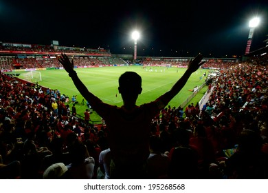 NONTHABURI THAILAND-APRIL 06:Unidentified fan of Muangthong utd.supporters  during Thai Premier League Muangthong utd. and Bangkok Glass F.C. at SCG Stadium on April 06,2014 in Thailand