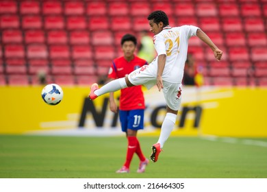 NONTHABURI THAILAND-SEPTEMBER 06:Badar Hamood Hashil Al-Jabri (white) of Oman in action during the AFC U-16 Championship between Korea Republic and Oman at Muangthong Stadium on Sep 06, 2014,Thailand