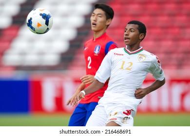 NONTHABURI THAILAND-SEPTEMBER 06:Yazod Khasib Zayid Al-Siyabi (R) of Oman in action during the AFC U-16 Championship between Korea Republic and Oman at Muangthong Stadium on Sep 06, 2014 Thailand
