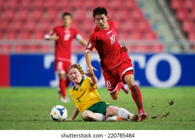 NONTHABURI THAILAND-SEPTEMBER 17:Choe Song Hyok no.10 (R) of DPR Korea in action during the AFC U-16 Championship between Australia and DPR Korea at Rajamangala Stadium on Sep17,2014,Thailand