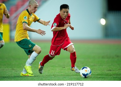 NONTHABURI THAILAND-SEPTEMBER 17:Jong Chang Bom (R) of DPR Korea control the ball during the AFC U-16 Championship between Australia and DPR Korea at  Rajamangala Stadium on Sep17,2014,Thailand