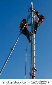 NONTHABURI,THAILAND,February,15.2020:Technicians wear safety equipment and climb tall telecommunication towers to assemble and install the transmitter.