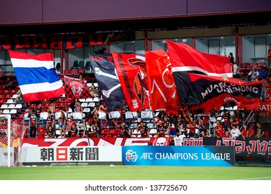 NONTHABURI,THAILAND-MAY 01:Unidentified of Muangthong Utd. Flag supporters during the AFC Champions League between Muangthong Utd.and Urawa Red Diamonds SCG Stadium on May 1,2013 in,Thailand.