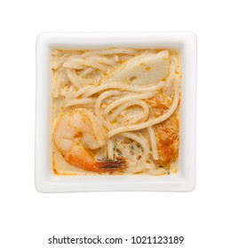 Nonya laksa in a square bowl isolated on white background