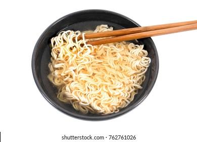 Noodle in bowl with bamboo chopsticks isolated on white background