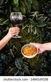 noodle and red wine in the hands