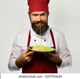 Noodles character. Funny chef man in burgundy hat eats pasta on grey background