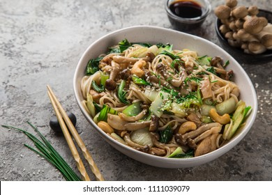 noodles with chicken, shimeji mushrooms and bok choy, selective focus