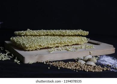 noodles flour candlenut black background