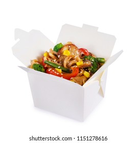 Noodles with meat mushrooms and vegetables in a paper box isolated on a white background