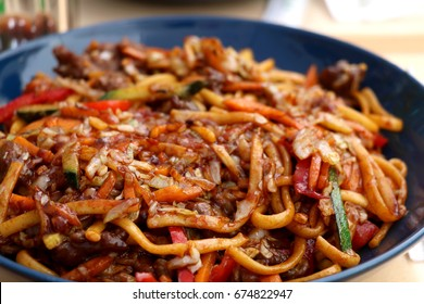 Noodles with meat and various vegetables - Asian fusion food. Selective focus.