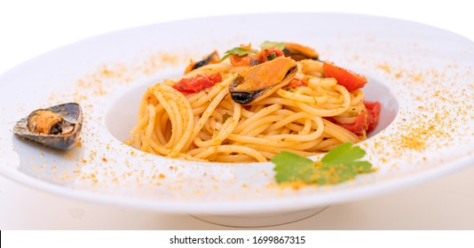 noodles with mussels bottarga fish and cherry tomatoes
