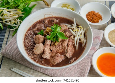 Noodles with pork and pork balls with soup Thai style. Thai peoples call Boat Noodles. Close up or selective focus