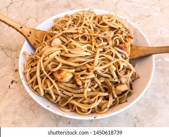Noodles with shrimp, teriyaki chicken and soy