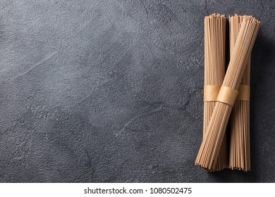Noodles soba on slate background. Traditional Japanese food. Top view. Copy space.