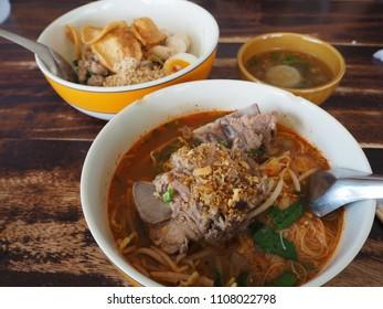 It's noodles Thai style. Soup Tomyam with pork bones.