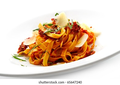 Noodles with tomato sauce and sliced dry cheese