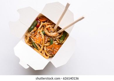 Noodles wok in cardboard box on isolated background