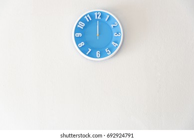noon or midnight time with 12:00 clock on white concrete wall interior background with copy space, message board concept. Noon is the lunch time , Midnight is the bed time