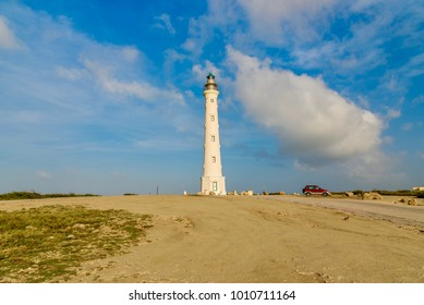 Noord, Aruba - January 4, 2018: Tourists visit the California Lighthouse in Aruba. The lighthouse took its name from the S.S. California which sank before its construction in 1910.