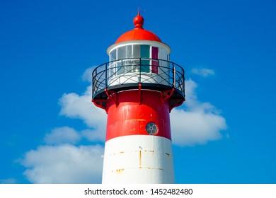 Noorderhoofd lighthouse on the deep blue sky near Westkapelle city, Zeeland province, The Netherlands