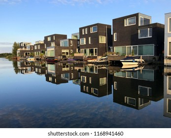 Noorderplassen, Almere, The Netherlands - August 31, 2018: Dutch houses on de waterside in the city of Almere.  Almere is the youngest and fastest growing city in the Netherlands.