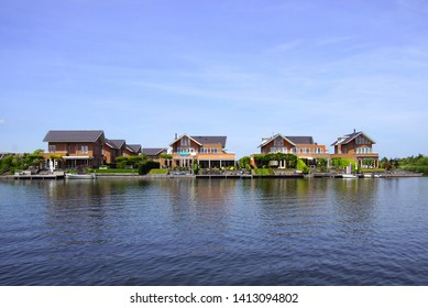 Noorderplassen, Almere, The Netherlands - June 1, 2019: Dutch houses on de waterside in the city of Almere.   city in the Netherlands.