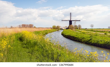 The Noordeveldse windmill in the Dutch village of Dussen, North Brabant is a wooden hollow post mill built in 1795. Previously, the mill was used to maintain the water level in the polder.