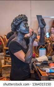 NOORDWIJK AAN ZEE-AUGUST 5, 2018. At the Beach Boulevard of Noordwijk, the Living Statue festival was held. In the dressing room several street artists worked on their make up and costumes.