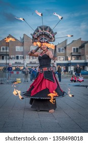 NOORDWIJK AAN ZEE-AUGUSTUS 19, 2018. At the Beach Boulevard of Noordwijk, the festival of Cirque des Dunes was held. Among other acts, there were artists who performed a fire dance.