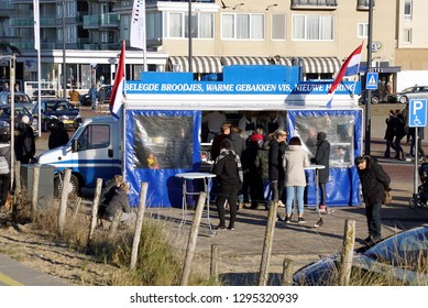 Noordwijk, the Netherlands - Januari 20, 2019: Dutch fresh fish food truck and unknown customers.