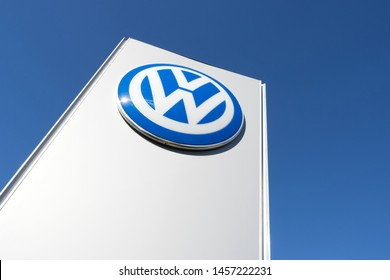 NOORDWIJK, THE NETHERLANDS - JUNE 29, 2019: Volkswagen dealership sign against blue sky. Volkswagen is a German automaker founded on 28 May 1937 and headquartered in Wolfsburg.