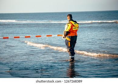 Noordwijk, The Netherlands - NOVEMBER 2018: lifeguard with barrier tape