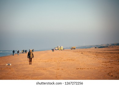 Noordwijk, The Netherlands - NOVEMBER 2018: people walking on the beach of Noordwijk