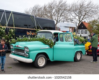 Noordwijkerhout, Netherlands - April 2,  2017: Old pick-up decorated with flowers at the traditional flowers parade Bloemencorso from Noordwijk to Haarlem in the Netherlands