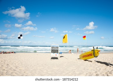NOOSA, QUEENSLAND, AUSTRALIA - MARCH 11; Noosa Beach, lifeguard station, flags denoting different conditions following a large storm on March 11, 2013 in Noosa Beach, Australia.
