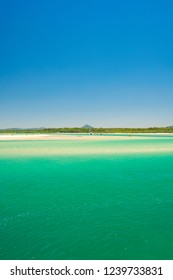 Noosa spit on a perfect day with blue water and blue sky on the Sunshine Coast in Queensland, Australia