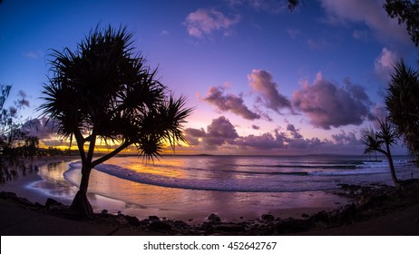Noosa Sunset. A wide angle shot of surfers enjoying the last light at First Point. Located at Noosa on the Sunshine Coast of Queensland, Australia.