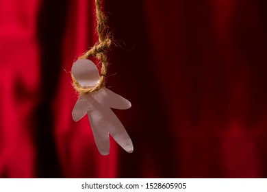 Noose over red curtain background. Suicide concept