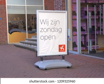Nootdorp, the Netherlands. October 2018. Sign outside a shop announcing sunday opening (English: We are open sunday).