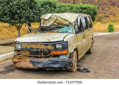 Nopolo, Baja California Sur, Mexico - August 25, 2013: A crashed car destroyed in the tropical storm named Juliette